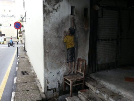 'Boy on Chair' mural by Ernest Zacharevic