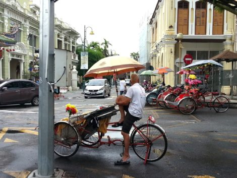 Penang Trishaw driver waiting for customers